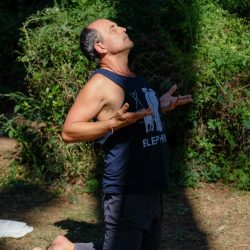 yoga teacher saul david raye during a masterclass in the park